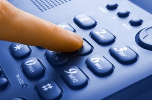 finger with green phone keypad